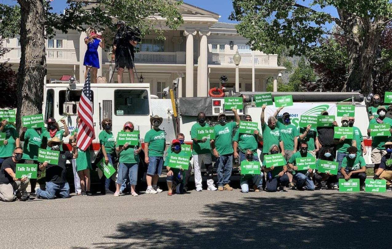 AFSCME Local 4041 members and supporters rally outside the Governor's Mansion in Carson City