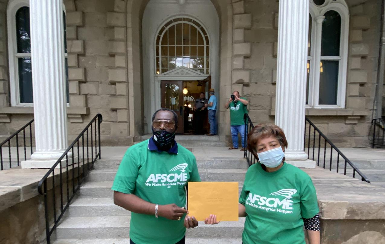 AFSCME Local 4041 members deliver UPL to Governor in Carson City