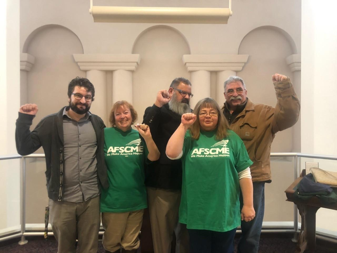 AFSCME Local 4041 members after stopping changes to an overtime rule at a personnel commission hearing