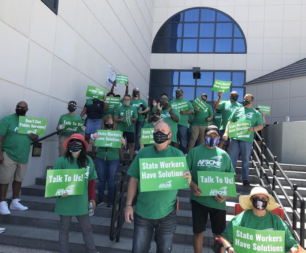 AFSCME Local 4041 members and supporters rally outside the Nevada State Business Center in Las Vegas